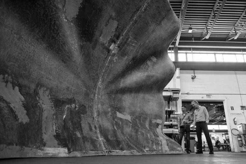man standing infront of fiberglass shell